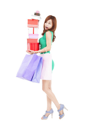 surprised young woman holding gift box and shopping bag Stock Photo - 24726354