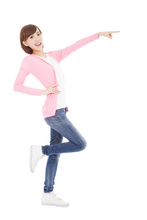 young  woman showing something to side  photo