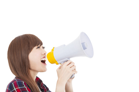 woman screaming: young woman holding megaphone