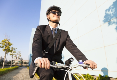 businessman riding a bicycle to workplace for protecting environment photo