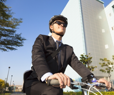 businessman riding a bicycle to workplace photo