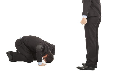 forceful: businessman apologize  to boss with japanese kneeling position