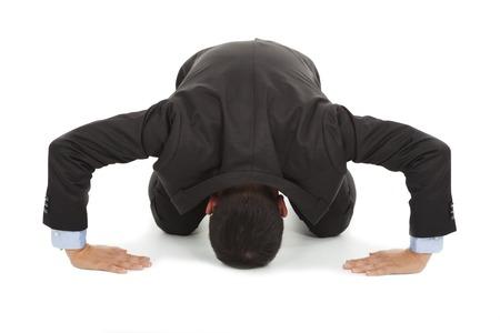 pardon: businessman apologize with japanese kneeling position