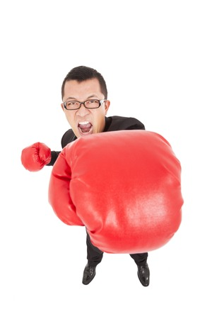 screaming businessman attack to enemy with boxing gloves photo