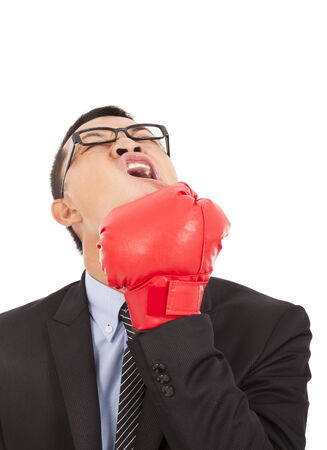 wrathful: businessman attack himself with boxing gloves  Stock Photo