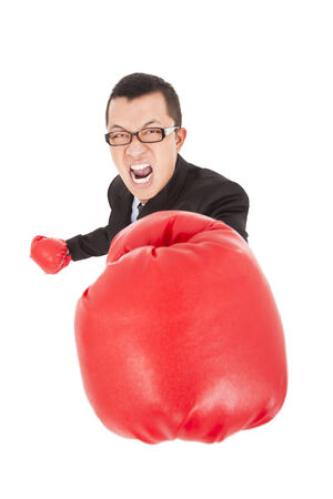 wrathful: angry businessman attack to enemy with boxing gloves Stock Photo