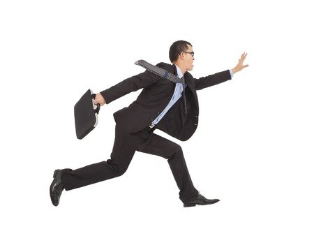 positive businessman running to catch goal photo