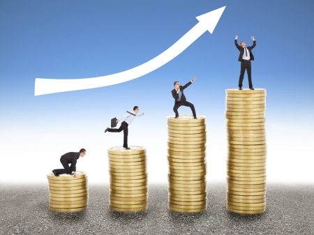 businessman goes up the gold coin, from  start to success photo
