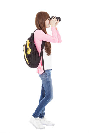 full length young girl taking a picture using digital camera photo