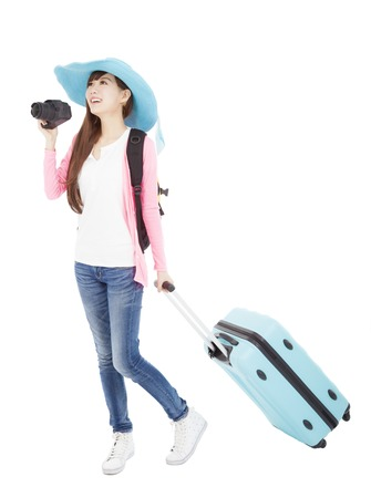 young woman holding  traveling case and camera photo