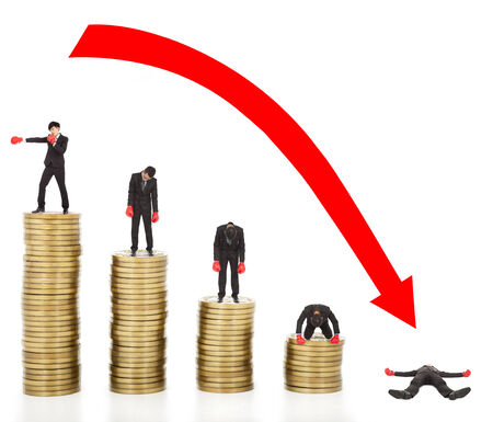 businessman lose coins with a red arrow going down photo