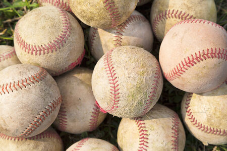 baseball field: Pile up a stack of old baseball in green