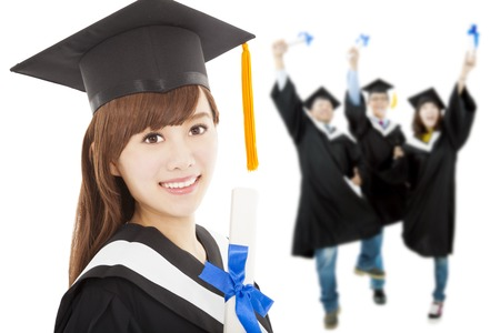 Young graduate girl student holding  diploma with classmates photo