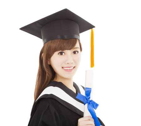 Young graduate girl student holding and showing diploma photo