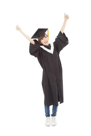 happy Young graduate girl student standing and hand up photo