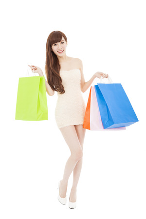 full length of  lovely asian woman with shopping bags photo