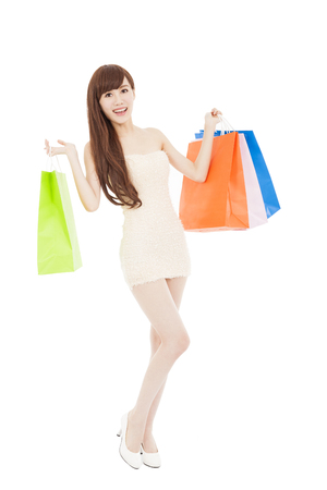 smiling and  lovely asian woman with shopping bags photo