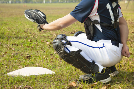 baseball catcher ready to catch ball at  home plate photo