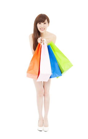 shopping woman holding many shopping bags excited photo