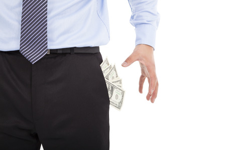 pulling money:  Business man grabbing  pocket money over white  Stock Photo