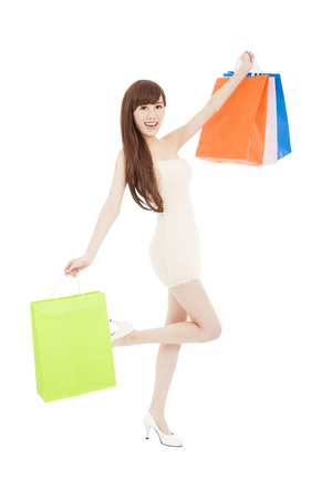Shopping woman happy smiling holding shopping bags photo