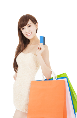 Young woman holding group shopping bag and credit card  photo