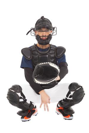 catcher: baseball player , catcher showing secret  signal gesture