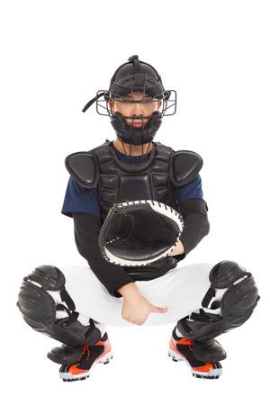 catcher: baseball player , catcher showing direction secret  signal