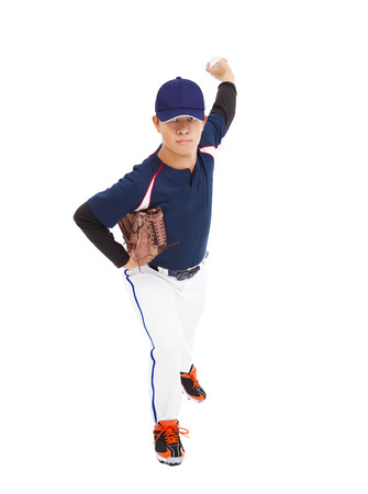 baseball player pitcher throwing ball  photo