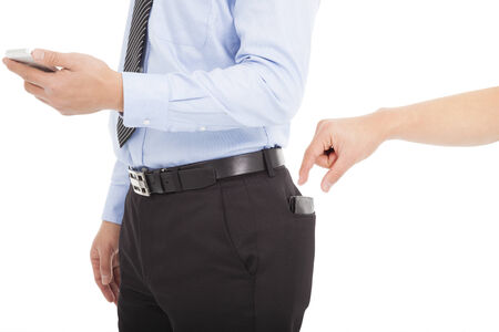 hand in pocket: thief hands are stealing wallet of business people Stock Photo