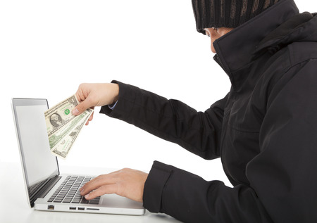 Hacker Steal money from the Internet with laptop  photo
