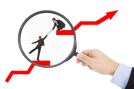 from magnifier , found business teamwork in stock market  Stock Photo