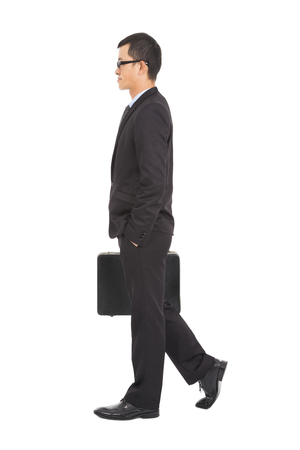 going business man holding brief case photo