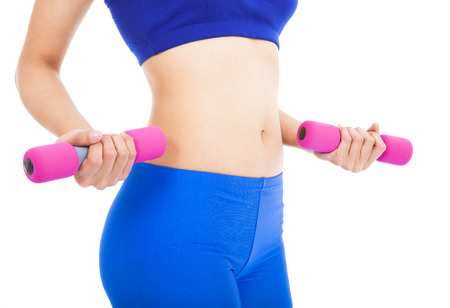 Woman's body part with fitness dumbell photo