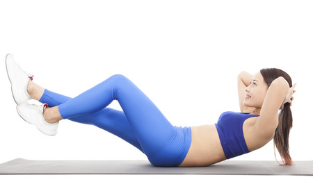 Woman doing abdominal crunches on exercise photo