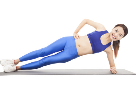 Young beautiful woman doing core workout Banque d'images