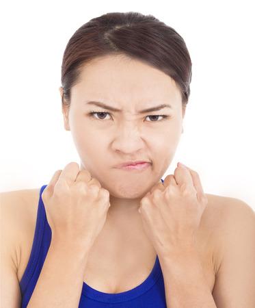 cabizbajo: Pu�o Chica linda con ira y la expresi�n facial Foto de archivo