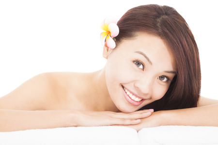 woman in spa salon lying on the massage desk with towel Stock Photo - 25296293