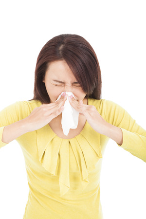 young Woman sneezing nose having cold photo
