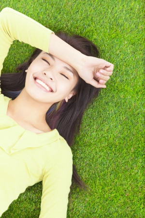 High angle view of a young woman resting on grass photo