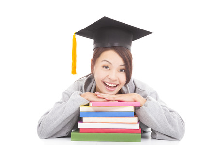 Portrait of happy student leaning on stacked books photo