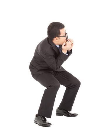 freaked: Asian businessman scared and afraid of something Stock Photo