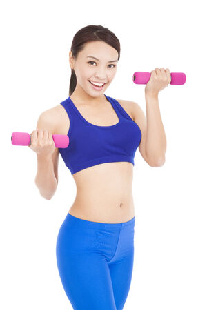 Happy fitness woman lifting dumbbells smiling cheerful, photo