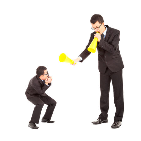 freaked: businessman blame or encourage to worker with megaphone