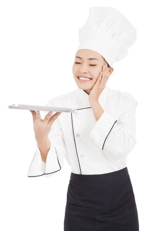 culinary skills: satisfied woman chef holding tray