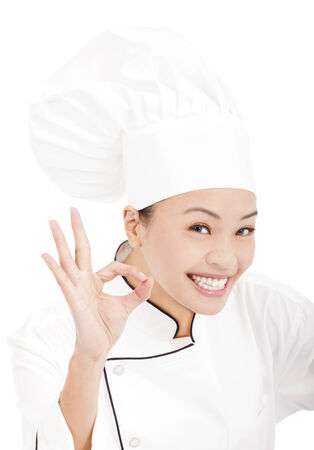 happy woman chef  showing ok hand sign photo