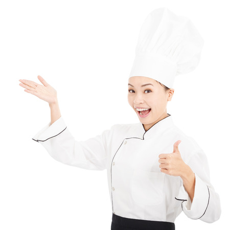 culinary skills: young graceful woman dressed as a cook with thumb up