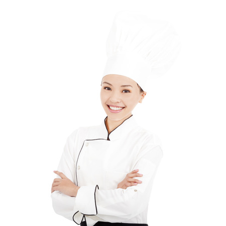 young pretty woman chef standing in studio photo