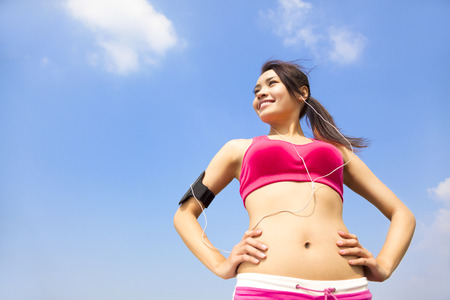 Running woman jogging outdoors listening to music Stock Photo - 25603451