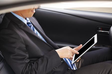 Comprimé d'affaires de toucher à la voiture Banque d'images - 25603461